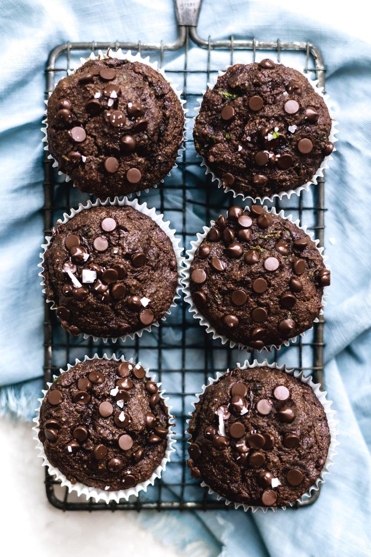 gluten free chocolate zucchini muffins on a cooling rack