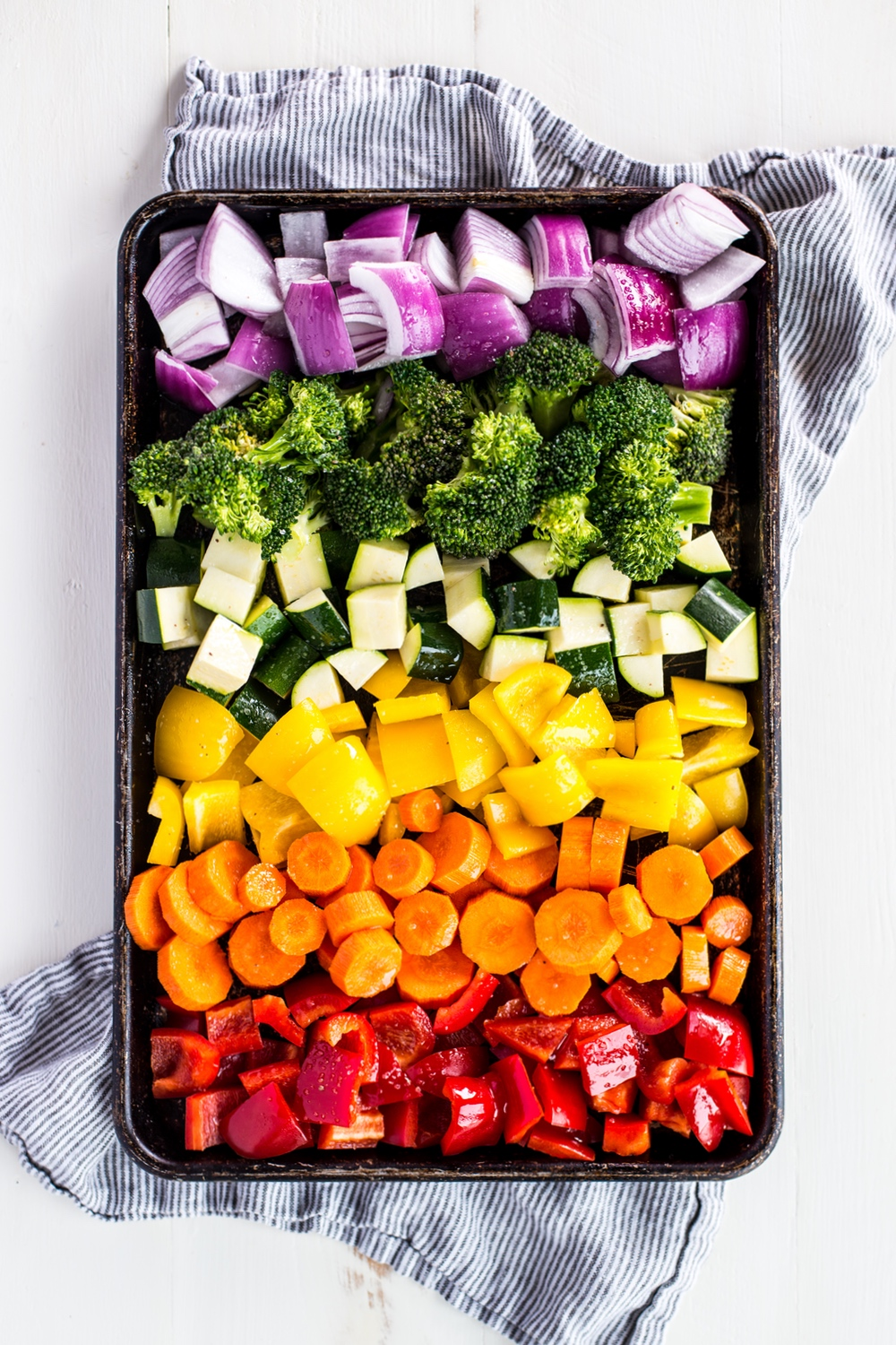 rainbow vegetables on a sheet pan ready to be cooked
