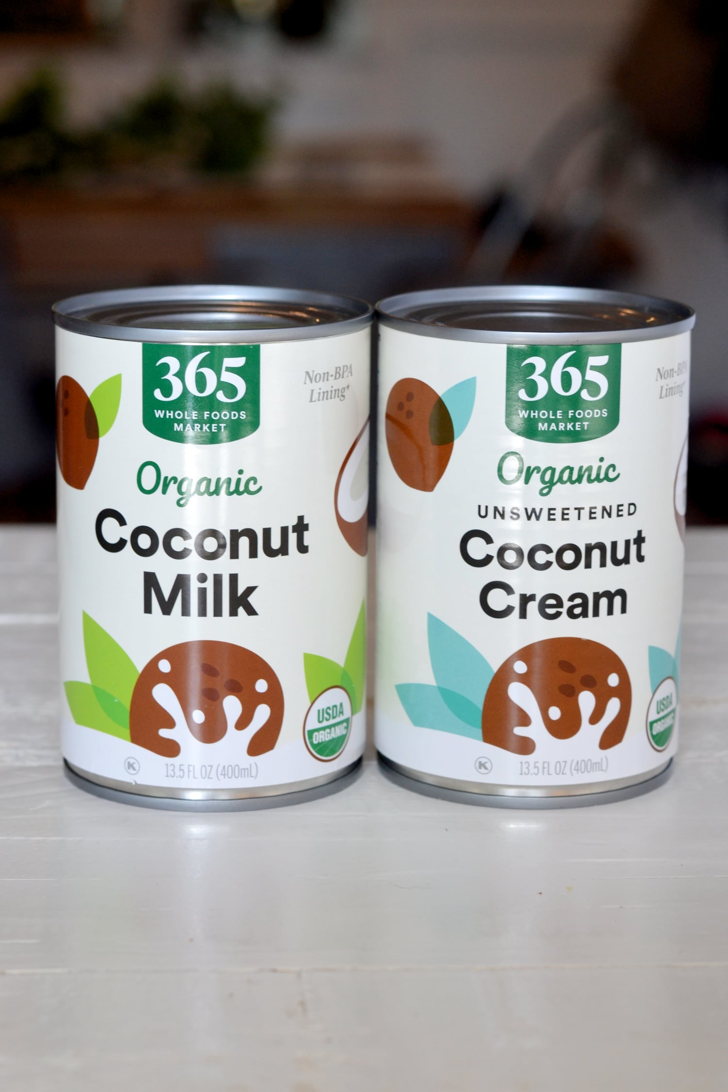 side by side comparison of coconut milk vs coconut cream in a can