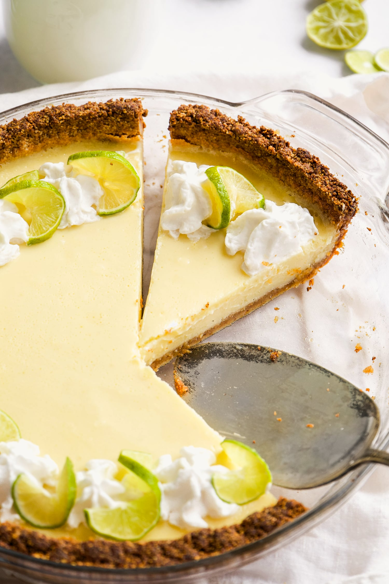 close up of slices of dairy free key lime pie in a pie dish