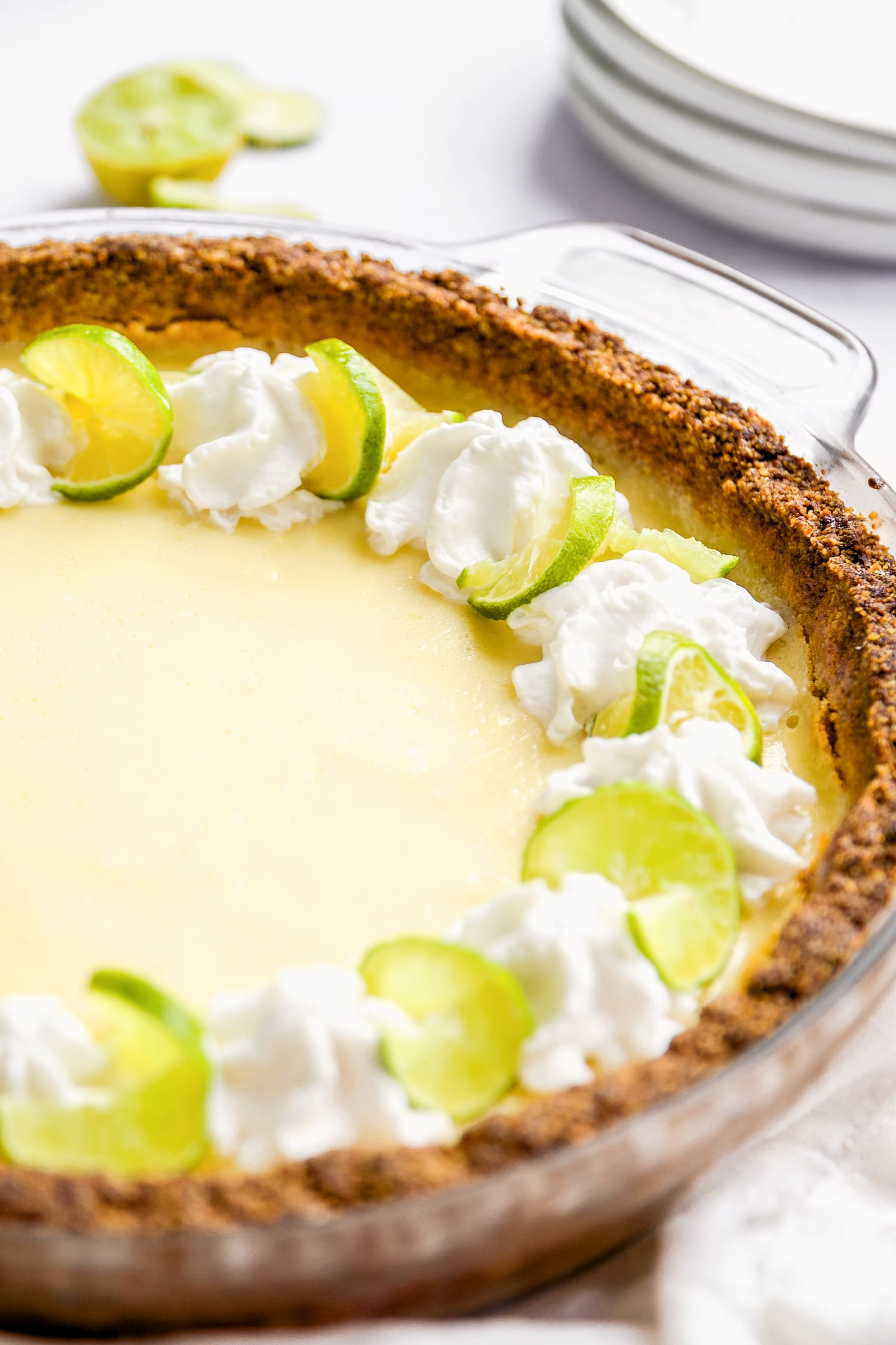 close up of whipped coconut cream on top of healthy key lime pie