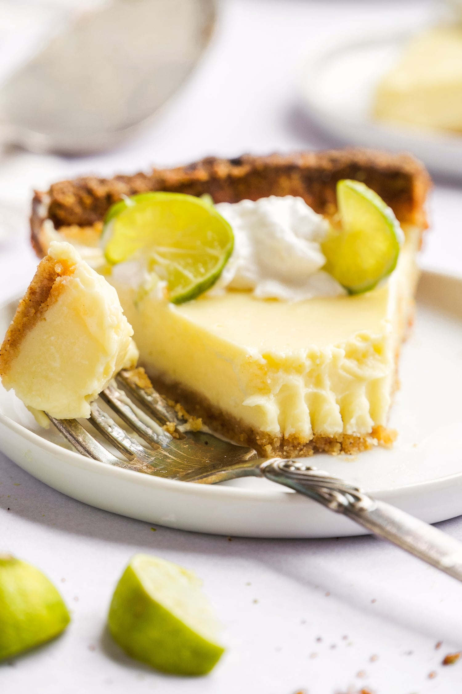 piece of dairy free key lime pie with bite taken out with a fork