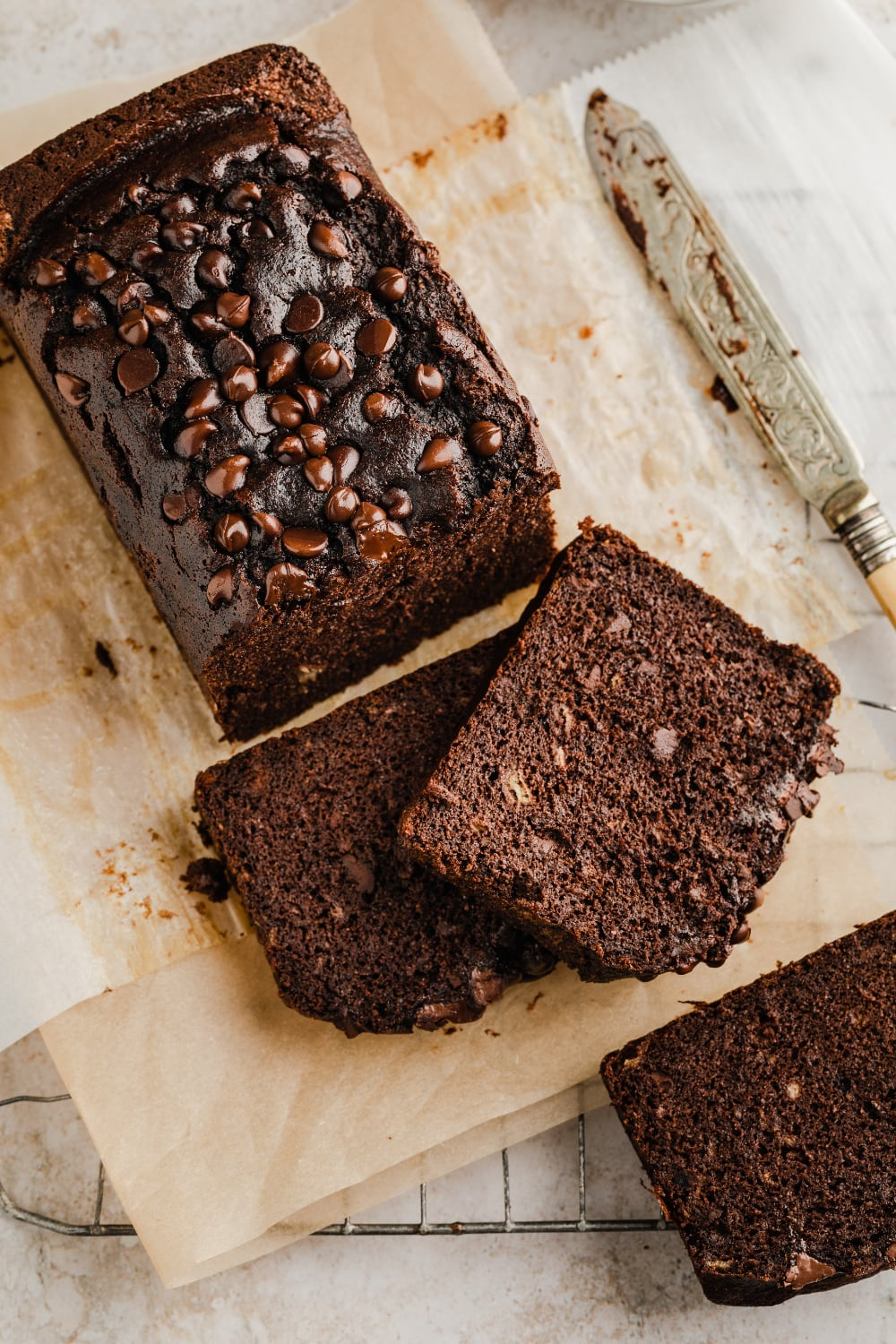 slices of paleo chocolate chip banana bread with a knife