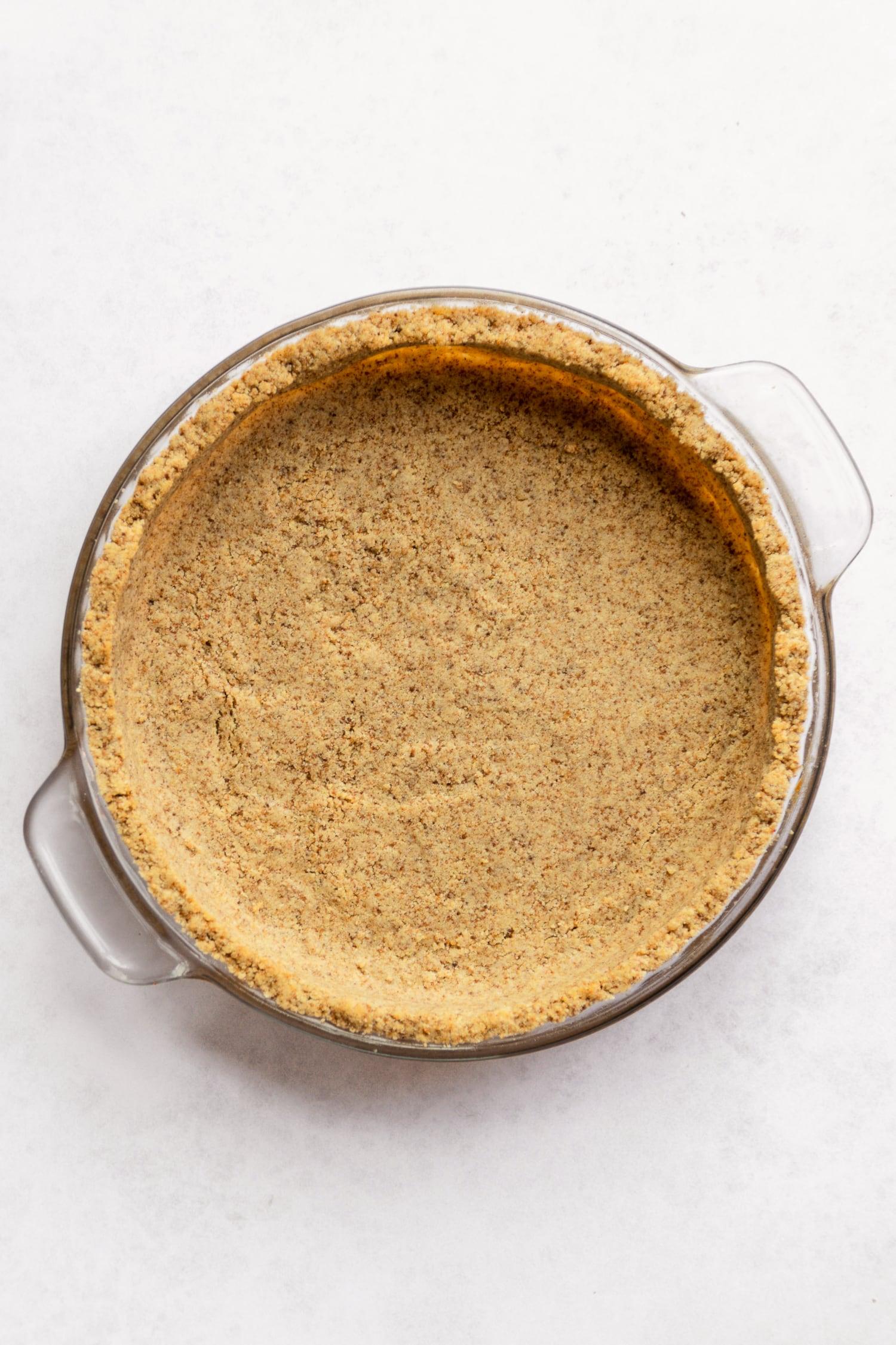 gluten free key lime pie crust in a pan