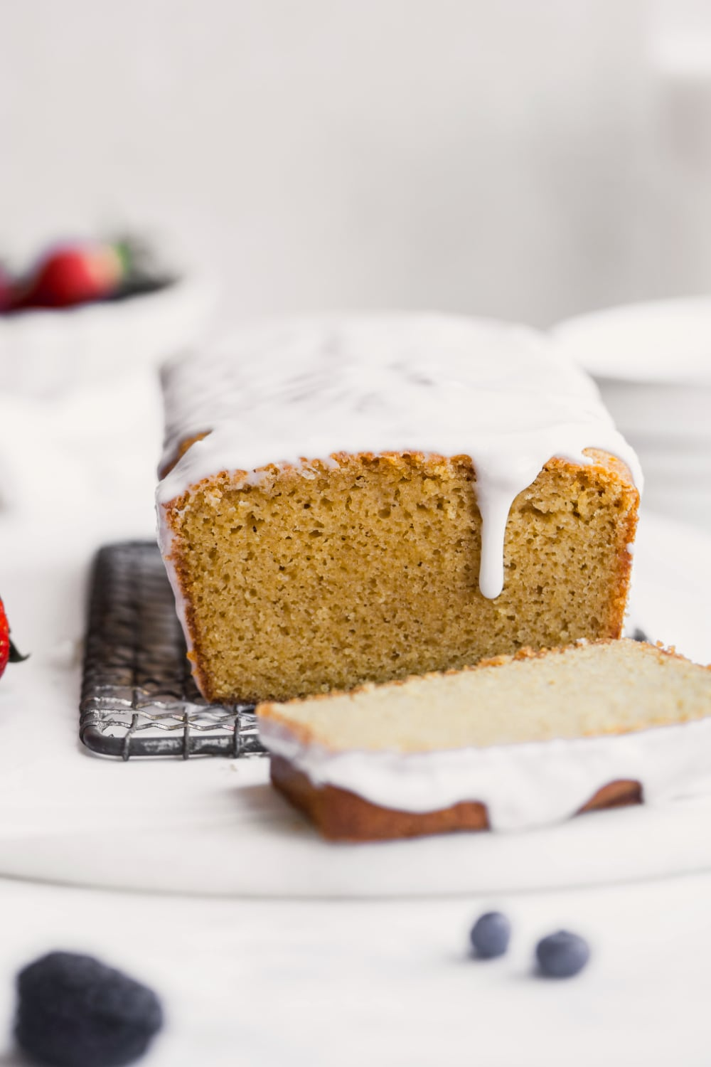 gluten free pound cake loaf with icing on top