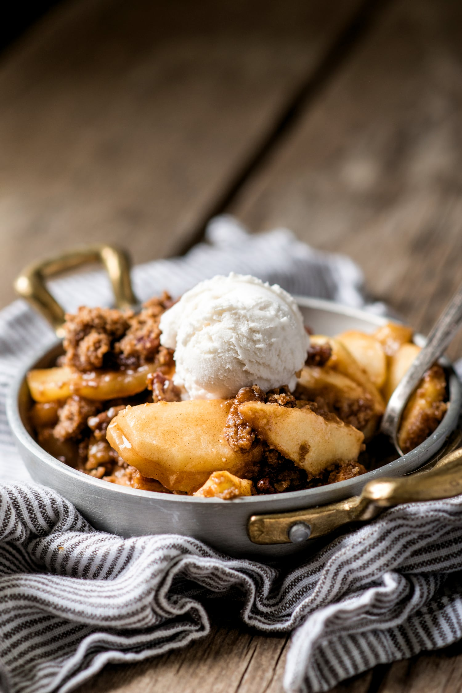 paleo apple crips in a bowl with coconut milk ice cream on top