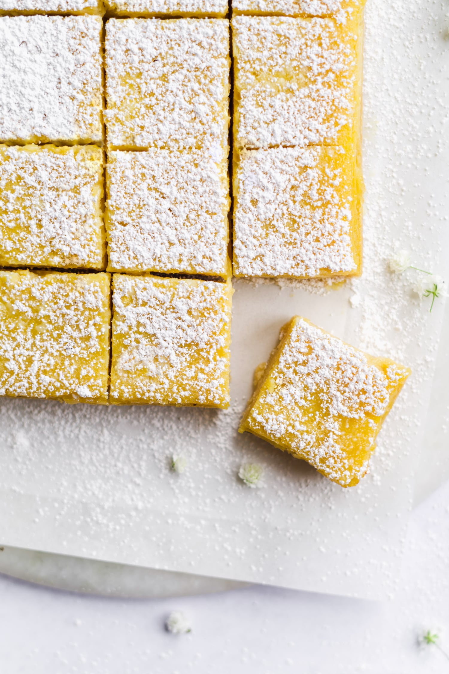 close up of lemon bar with powdered sugar on top