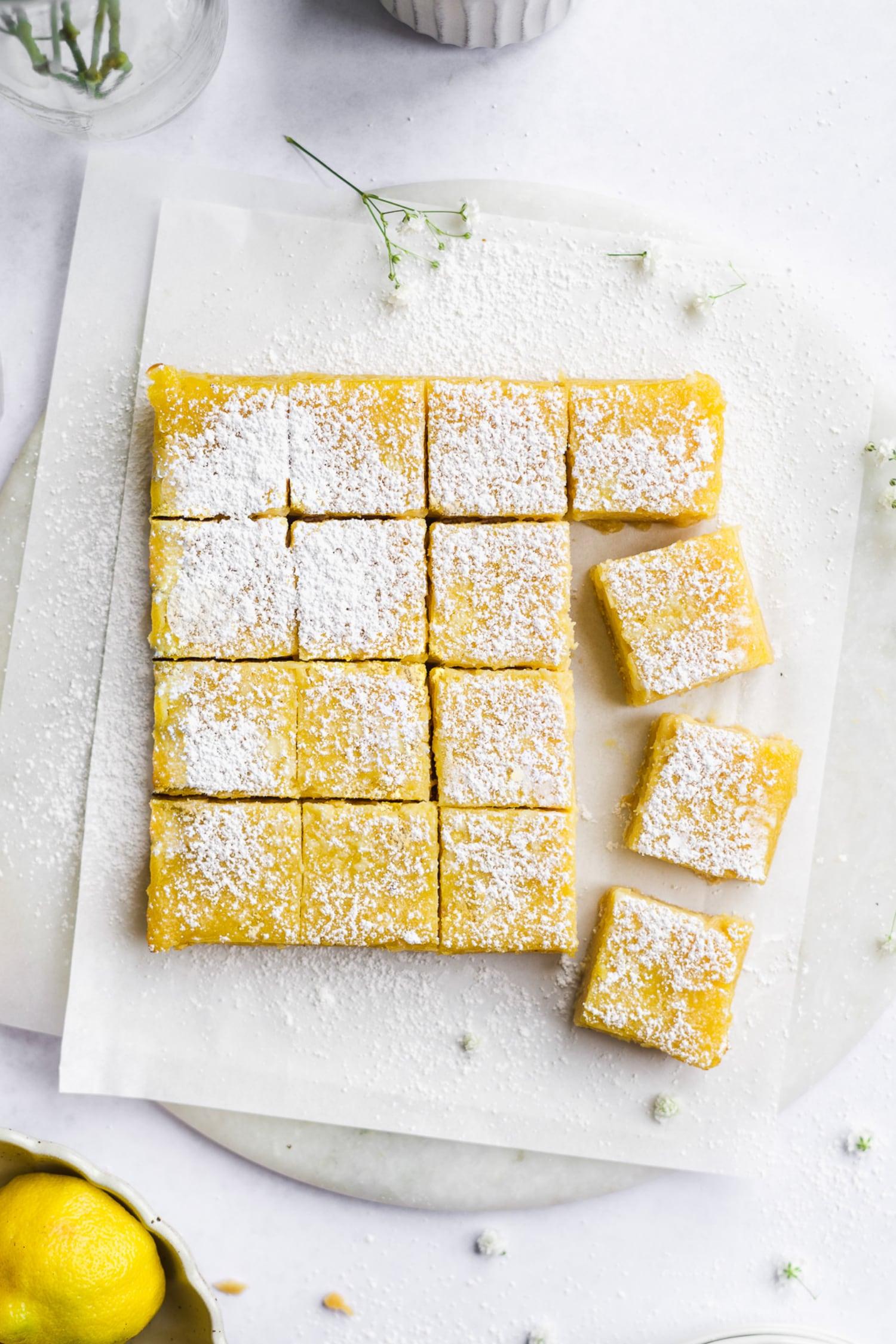 a batch of healthy lemon bars on wax paper