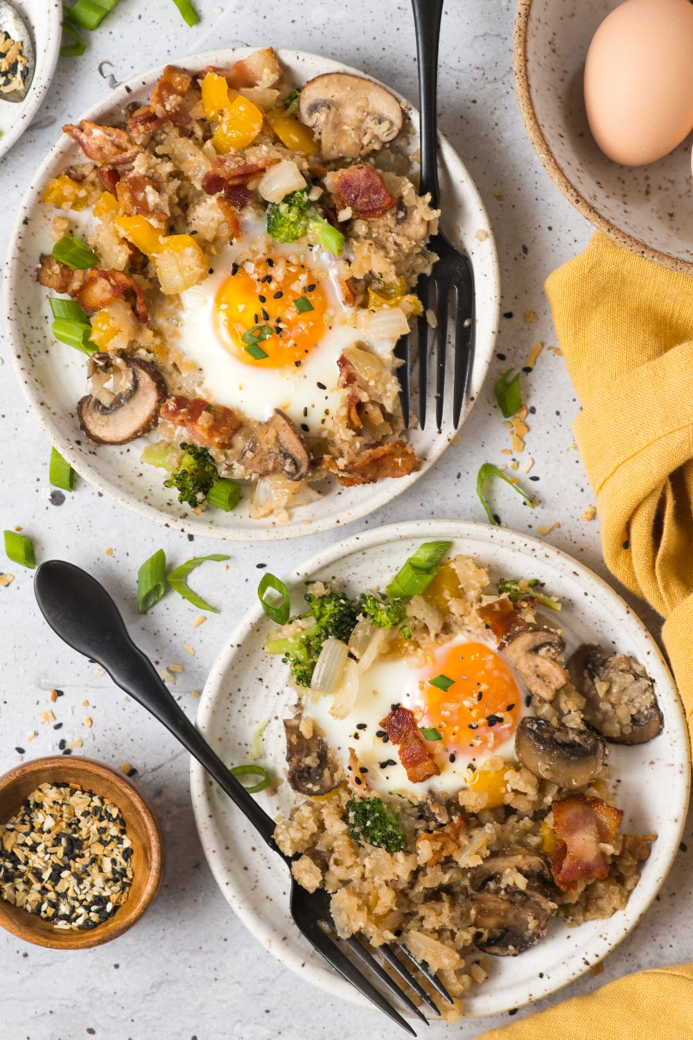 two plates of paleo breakfast fried rice