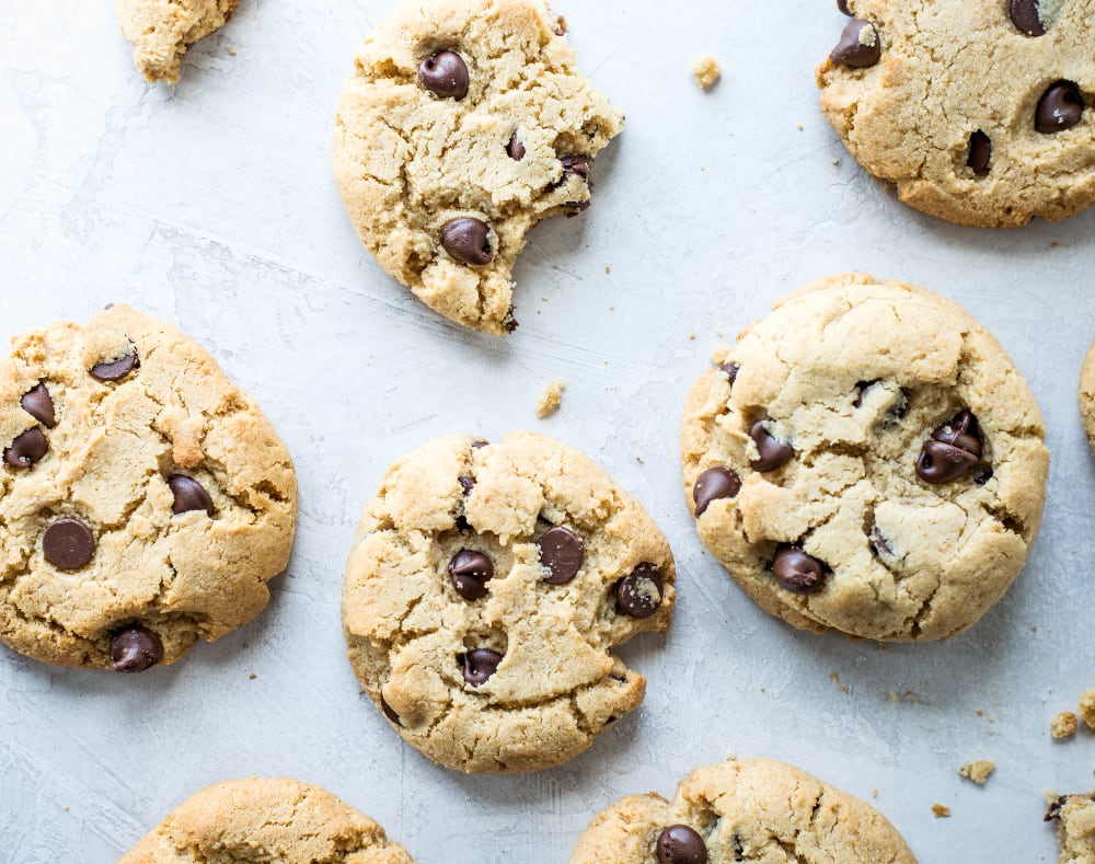 chewy chocolate chip cookies with a bite taken out