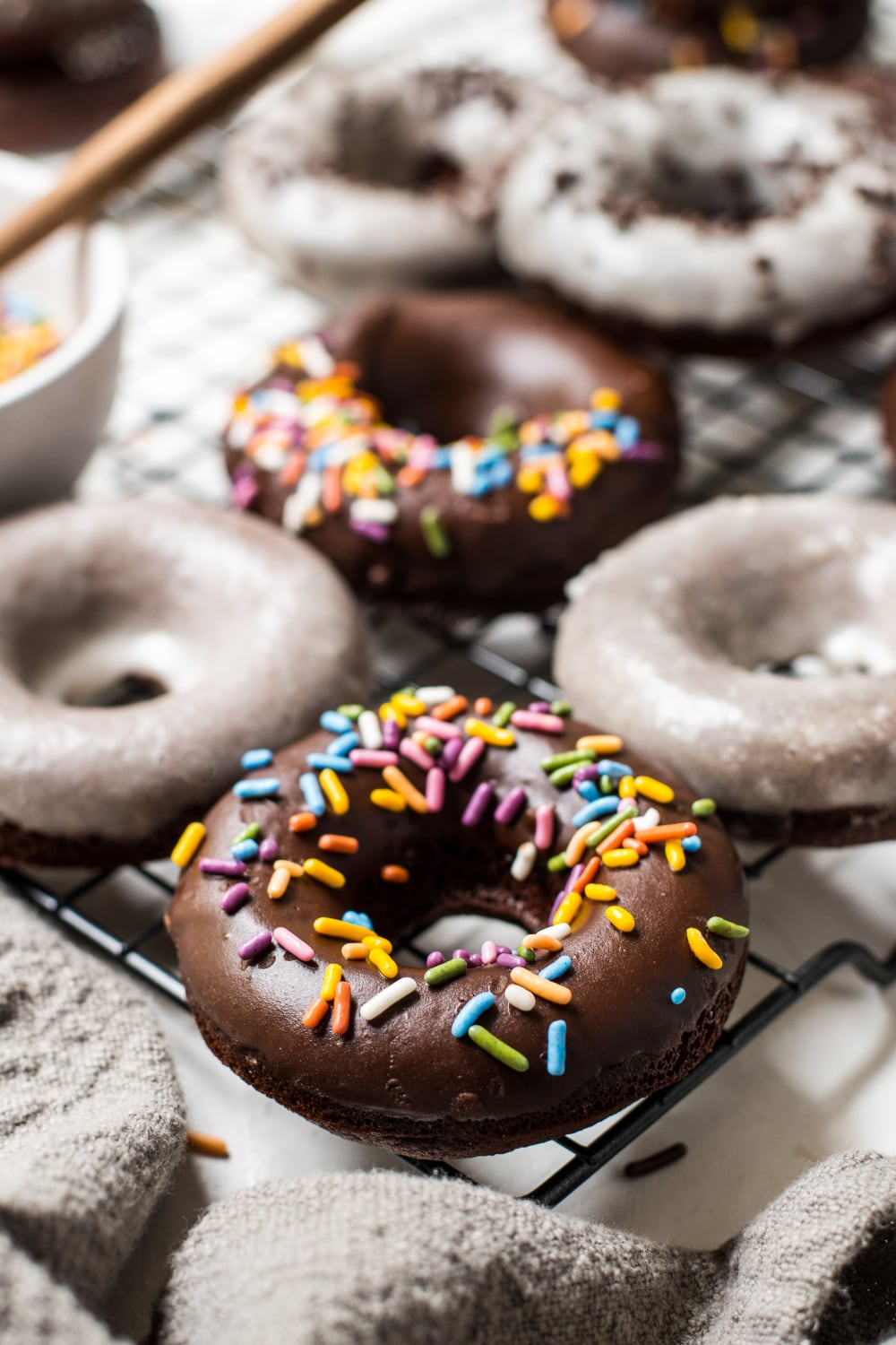 a paleo chocolate frosted donut with sprinkles