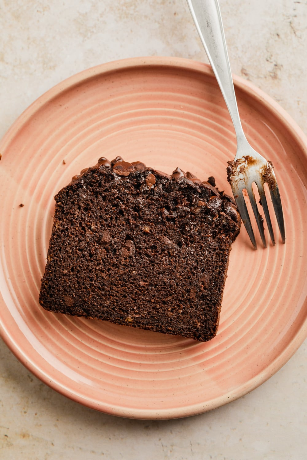 a slice of paleo chocolate banana bread on a place