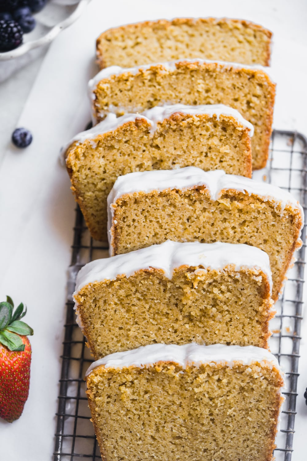 pound cake sliced up and laying flat on a cooling rack