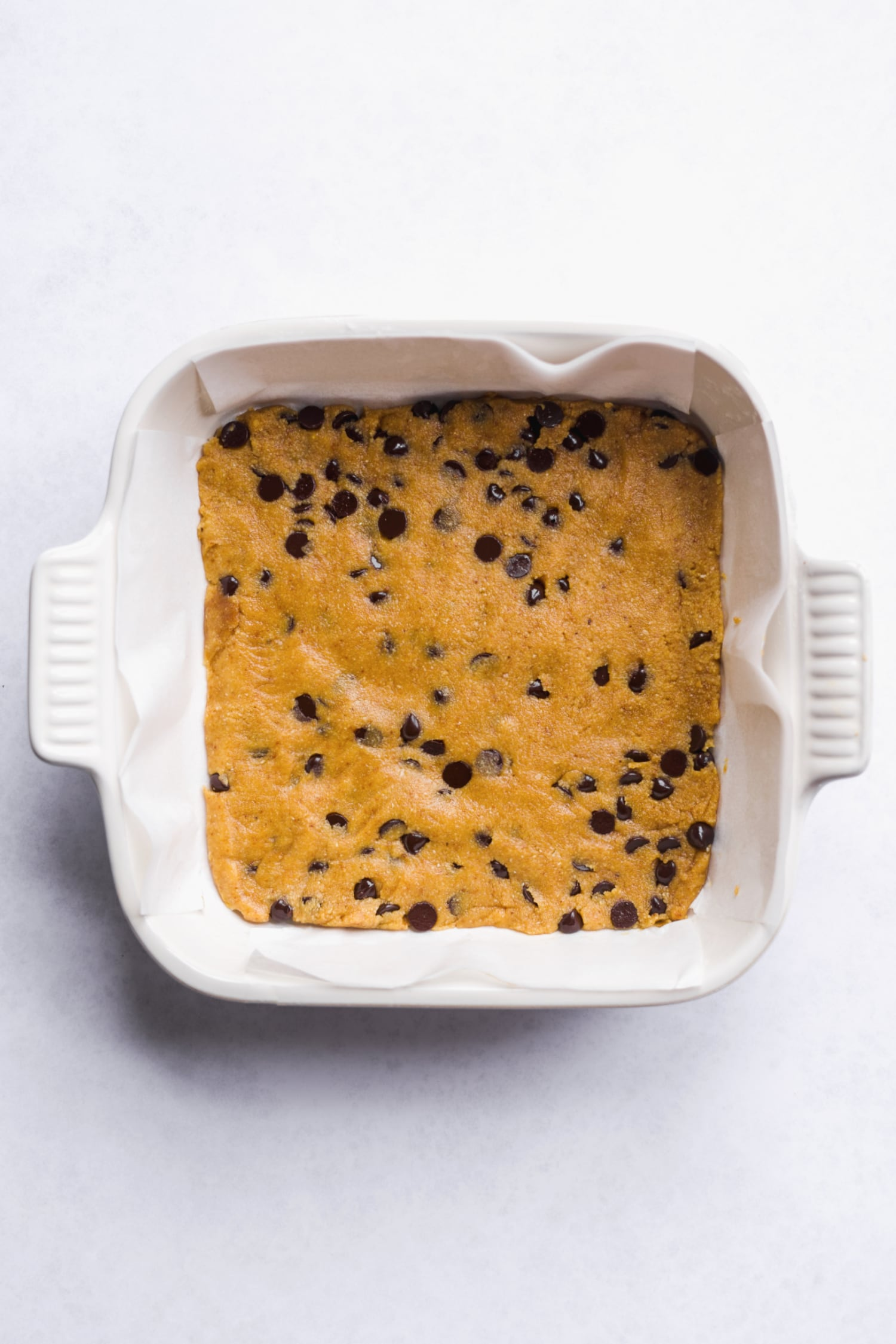base layer of paleo cookie dough in the pan