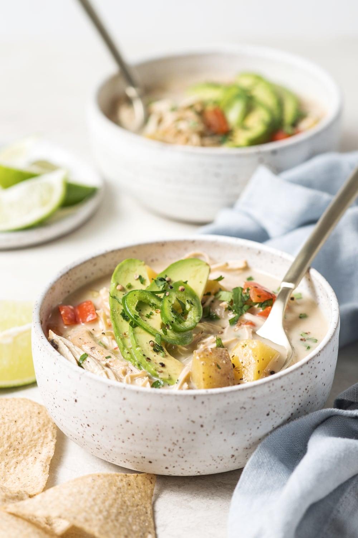 two bowls of crockpot paleo white chicken chili